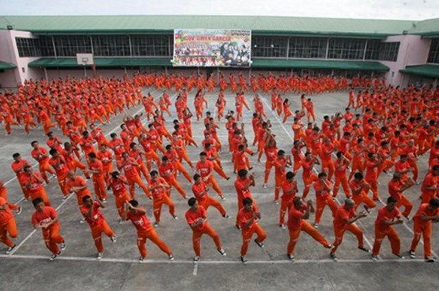 "PRISON DANCE. Cebu convicts dance to the tune of the horse-riding dance ""Gangnam Style"" made famous by South Korean rapper Psy during a performance for visitors and toruists at the Provincial Detention and Rehabilitation Center in Cebu on October 27, 2012. Philippine convicts who became famous for dancing to Michael Jackson's hits have added South Korean spice to their repertoire, with a performance of the popular ""Gangnam Style"" rap. Photo by AFP"