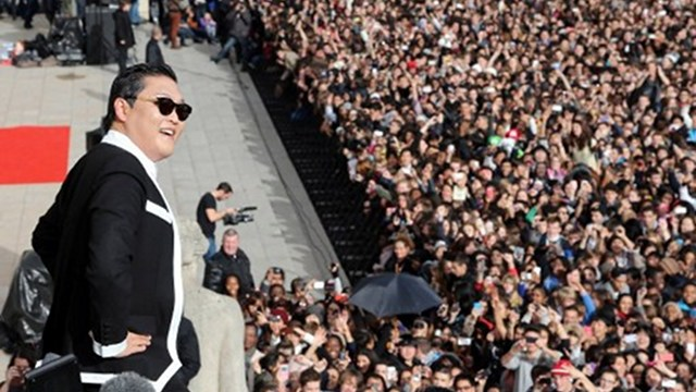 "VIRAL. South Korean rapper Park Jae-Sang, also known as Psy, performs ""Gangnam Style"" in front of a crowd during a flashmob on November 5, 2012 in Paris. The video to ""Gangnam Style"" went viral after its July release, becoming the second most viewed clip in YouTube history, where it has notched up more than 650 million hits despite being sung almost entirely in Korean. Photo by AFP"
