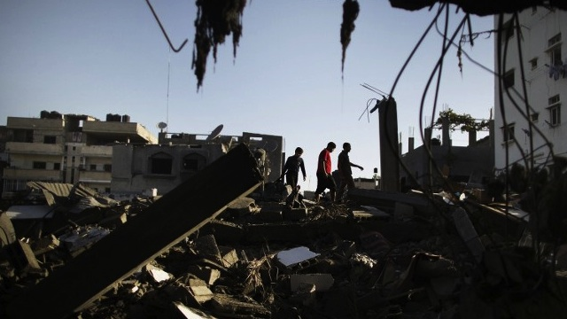 GAZA DAMAGE. Palestinians salvage for belongings from their destroyed houses following overnight Israeli air strikes on the village of Beit Lahia in the northern Gaza Strip on November 18. AFP photo/Marco Longari