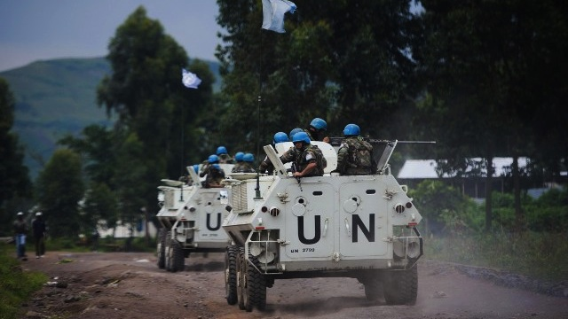 TENSIONS IN GOMA. United Nations armored personnel carriers drive towards a UN base in Monigi, 5kms from Goma, in eastern Democratic Republic of the Congo, on November 18, 2012. AFP PHOTO / PHIL MOORE