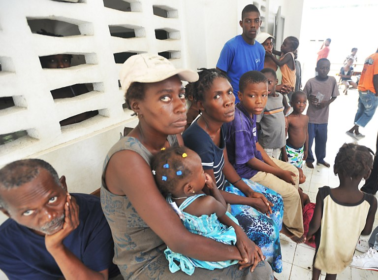 'SANDY' VICTIMS. Haitians left homeless by Hurricane Sandy, sit November 17, 2012 in the Nippes section of Haiti. AFP PHOTO / Thony BELIZAIRE
