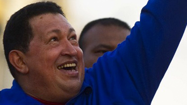 Venezuelan President Hugo Chavez greets supporters during a campaign rally in Monagas on September 28, 2012. AFP PHOTO/JUAN BARRETO