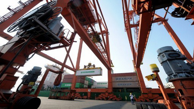 BETTER INCOME. ICTSI says growth is driven by strong port revenues. Photo by AFP