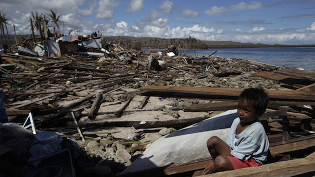SOLACE. A child manages a smile amid the devastation. Photo by John Javellana