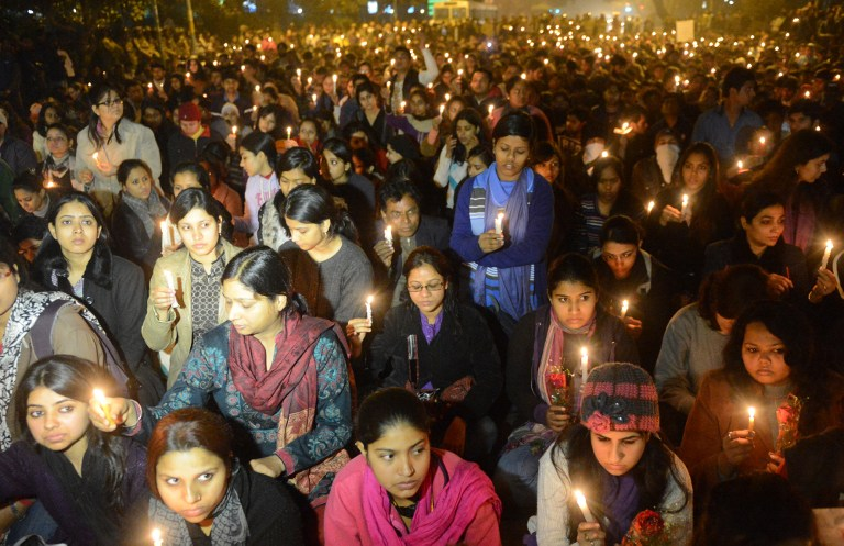 INDIA IN MOURNING. Indian protestors hold candles during a rally in New Delhi on December 29, 2012, after the death of a gang rape student from the Indian capital. AFP PHOTO/RAVEENDRAN