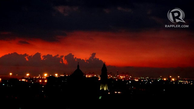 LIKE FIERY LOVE. Manilas skyline as viewed from Bayleaf Hotels rooftop