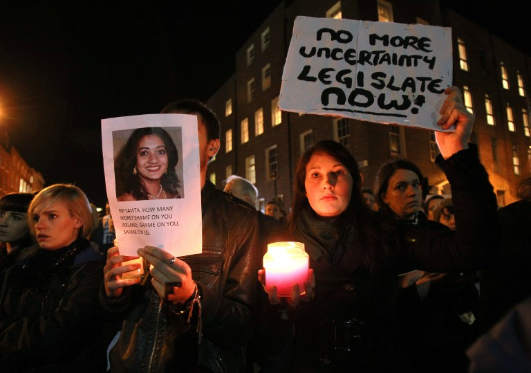 FOR ABORTION. Protestors hold pictures of Indian Savita Halappanavar, who was allegedly refused a pregnancy termination after doctors told her it was a Catholic country, as they gather outside Leinster House (Irish Parliament building) during a demonstration in favor of abortion legislation in Dublin, Ireland, on November 14, 2012. AFP PHOTO/ PETER MUHLY