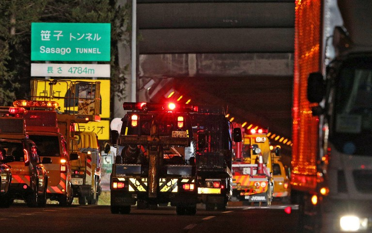 Operation vehicles continue with the rescue as they enter the Sasago tunnel along the Chuo highway near the city of Otsuki in Yamanashi prefecture, 80 kms west of Tokyo on December 2, 2012 after part of the tunnel collapsed. AFP PHOTO / JIJI PRESS