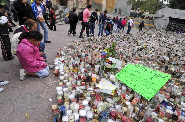 IN MOURNING. Fans of Mexican-US singer Jenni Rivera remain next to hundreds of candles outside the Arena Monterrey, where she performed her last show, in Monterrey, Nuevo Leon state, Mexico on December 10, 2012. AFP PHOTO /STR
