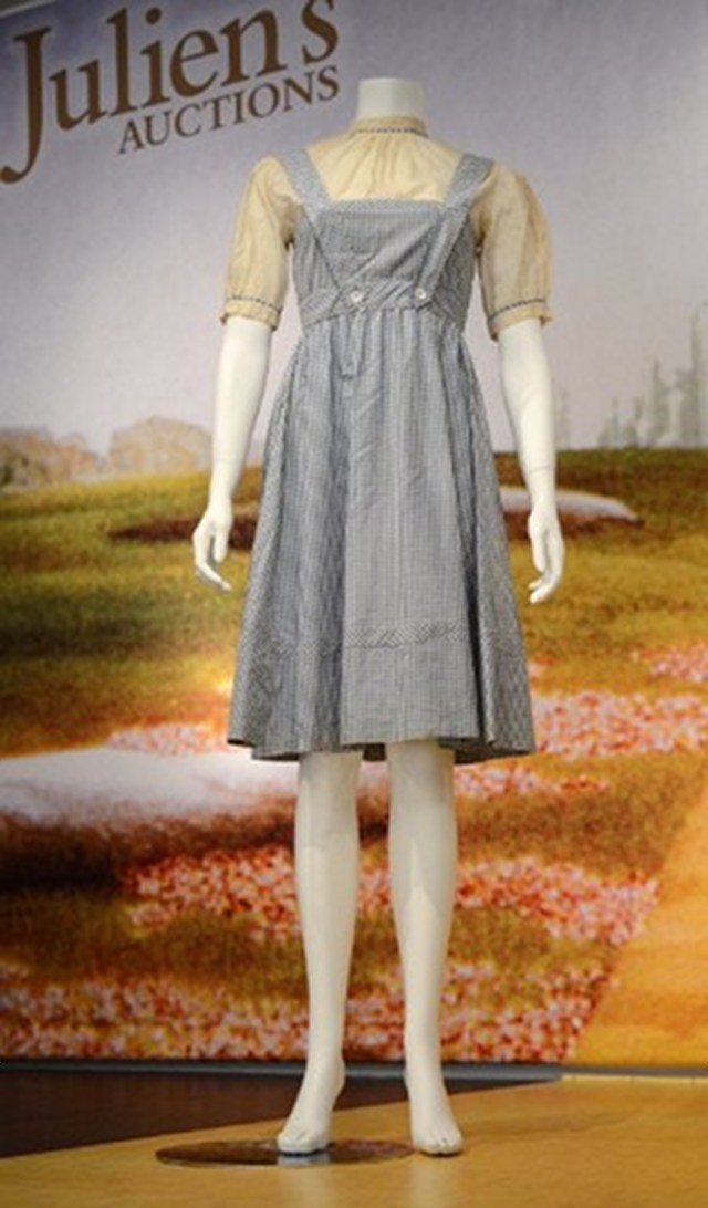 AUCTION. Judy Garland's Dorothy Gale blue gingham dress from The Wizard of Oz As Dorothy Gale, was auctioned off at Julien's Auctions in Beverly Hills. Photo by AFP