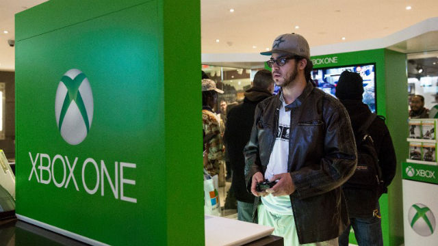 ALL NEW. A man plays an XBox One - a new video game console and home entertainment system made by Microsoft.