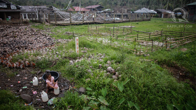 A young girl collects drinking water in storm-ravaged Lingig in Surigao del Sur. 3 Jan 2013, Photo by John Javellana.