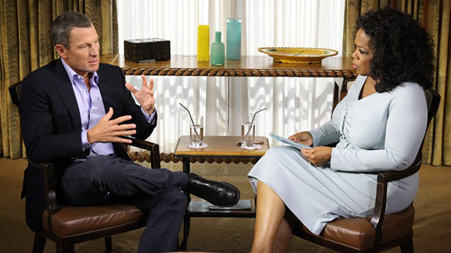 Cyclist Lance Armstrong talks to Oprah Winfrey. GEORGE BURNS / AFP