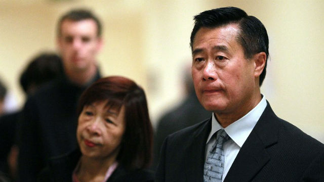 SUSPECT. California State senator and candidate waits outside polling station with his wife Maxine Yee inside San Francisco City Hall in 2011 when he was mayoral candidate. The senator is now facing federal charges of corruption and racketeering, among other crimes. Photo by Justin Sullivan/Getty Images/AFP