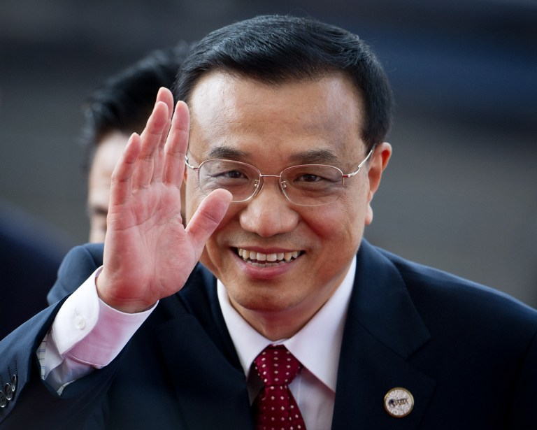 NEW PREMIER. In a file picture taken on April 2, 2012, China's Vice Premier Li Keqiang waves as he arrives for the opening ceremony of the Boao Forum for Asia on the southern Chinese island of Hainan. AFP PHOTO / POOL / Ed Jones / FILES