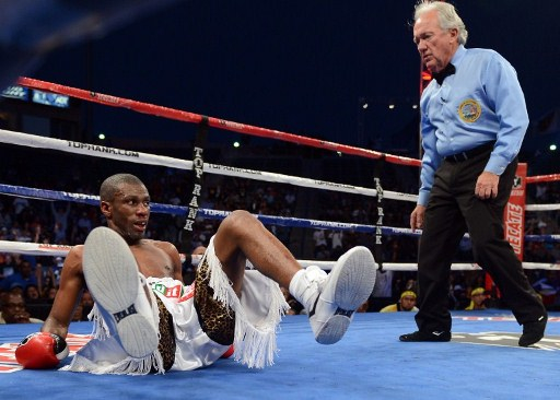 SAVED BY THE BELL. Jeffry Mathebula falls in Round 4 but stands up before the bell. Photo by AFP