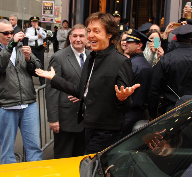 THERE AND GONE. McCartney arrives by taxi at Times Square. Photo: Kevin Mazur/Getty Images/AFP