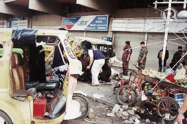 SEARCH. Investigators sift through the rubble after an explosion outside the Fitmart Department Store in April 2002. Photos by Edwin Espejo