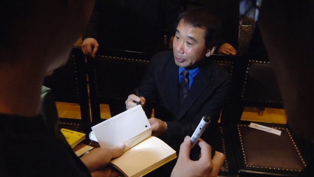Japanese writer Haruki Murakami signs autographs 30 October 2006 in Prague after receiving the Franz Kafka Award for 2006. AFP PHOTO MICHAL CIZEK