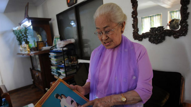 THE SIMPLE LIFE. The granddaughter of Myanmar's last king, princess Hteik Su Phaya Gyi shows her photo during an interview at her residence in Yangon. AFP Photo