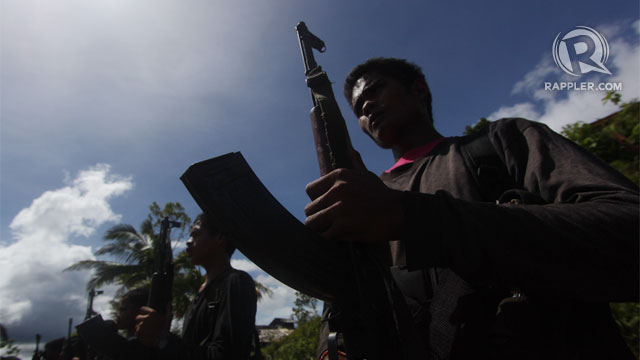REBEL TERRITORY. NPA guerilla fighters performing a military drill somewhere in the mountains of Laak town in Comspotela Valley. File photo by Karlos Manlupig