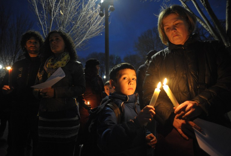 Gun control supporters take part in a candlelight vigil at Lafayette Square across from the White House on December 15, 2012 in Washington. Twenty-seven people, including the shooter, were killed on December 14 at Sandy Hook Elementary School in Newtown, Connecticut. AFP PHOTO/Mandel NGAN