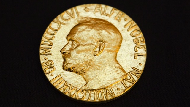 This picture taken on December 10, 2010 shows the front of the Nobel medal awarded to the Nobel Peace Prize laureate for 2010, jailed Chinese dissident Liu Xiabo. AFP PHOTO / SCANPIX - Berit Roald