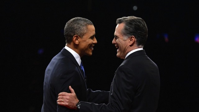 Republican presidential candidate Mitt Romney (R) and US President Barack Obama (L) greet one another at Magness Arena moments before the start of their first debate at the University of Denver in Denver, Colorado, October 3, 2012. AFP PHOTO / Pool / Michael REYNOLDS