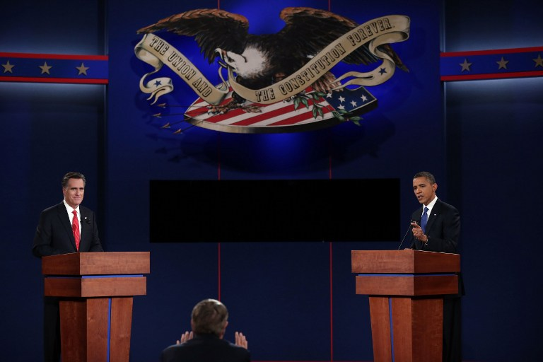 Debate moderator Jim Lehrer (C) speaks to Democratic presidential candidate, U.S. President Barack Obama (R) and Republican presidential candidate, former Massachusetts Gov. Mitt Romney (L) during the Presidential Debate at the University of Denver on October 3, 2012 in Denver, Colorado. The first of four debates for the 2012 Election, three Presidential and one Vice Presidential, is moderated by PBS's Jim Lehrer and focuses on domestic issues: the economy, health care, and the role of government. Win McNamee/Getty Images/AFP