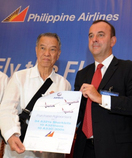 DEAL SEALED. PAL chairman Lucio Tan (left) and Airbus senior VP for Asia Jean Francois Laval (right) pose after they announced the biggest aircraft deal in the Philippines that is part of spectacular move to rejuvenate Asia's oldest carrier. Photo by AFP
