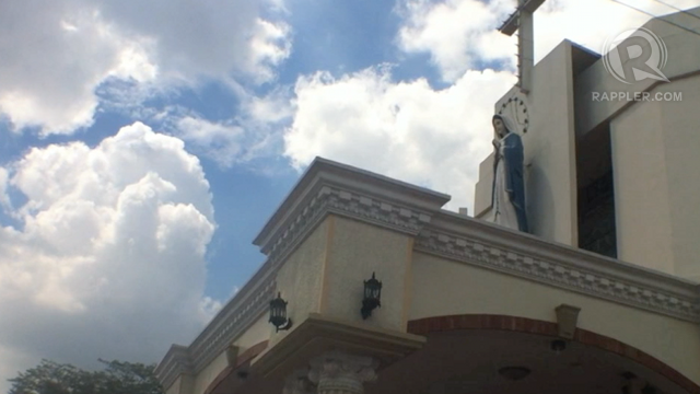 BROKEN VOWS. Clouds loom over a Roman Catholic church in Pampanga