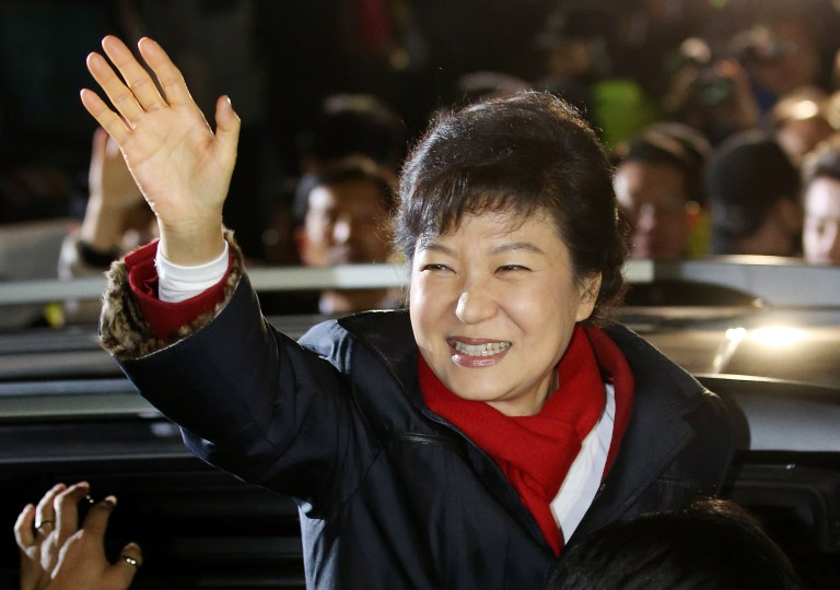 MADAME PRESIDENT. South Korea's president-elect Park Geun-Hye from the ruling New Frontier Party, waves to supporters outside the party headquarters in Seoul on December 19, 2012. AFP PHOTO/DONG-A ILBO