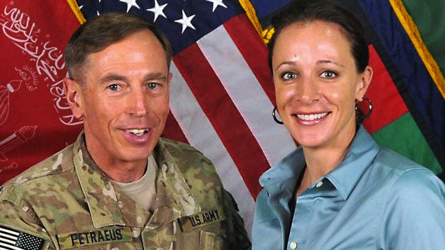 This July 13, 2011 handout image provide by International Security Assistance Force NATO, shows them ISAF Commander Gen. David Petraeus poses with his biographer Paula Broadwell in Afghanistan. AFP PHOTO / HANDOUT / ISAF NATO