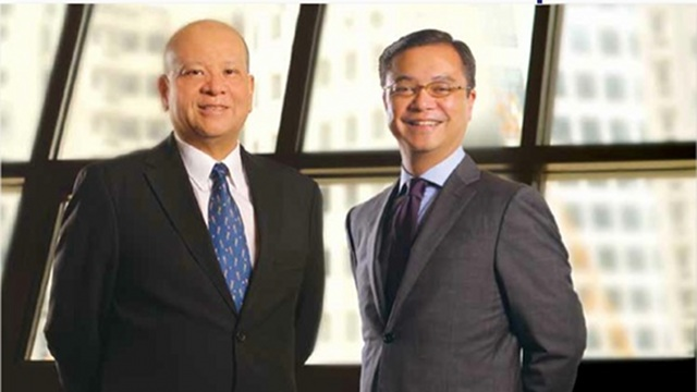 CHANGES AT THE TOP. Eric Recto (right) steps down as president of the country's biggest oil refiner and retailer. He is shown here with Petron Corp's chairman and CEO Ramon Ang (left). Photo from Petron's 2011 annual report