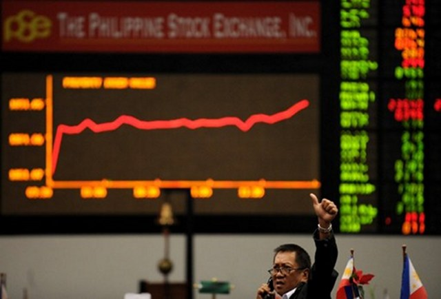 GOING UP. The main index of the Philippine Stock Exchange still breaking records. Photo by AFP