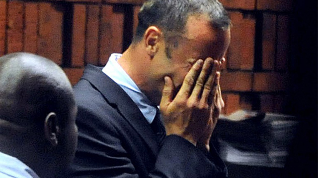 THE BULLET. South Africa's Olympic sprinter Oscar Pistorius buries his face in his hands during his hearing. He is charged with the murder of his model girlfriend Reeva Steenkamp. AFP PHOTO/ Antoine de Ras