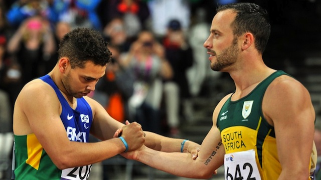 South Africa's Oscar Pistorius (R) shakes hands with Brazil's Alan Fonteles Cardoso Oliveira (L) after competing in the Men's 200m T44 Final athletics event during the London 2012 Paralympic Games at the Olympic Stadium in east London, on September 2, 2012. AFP PHOTO / GLYN KIRK