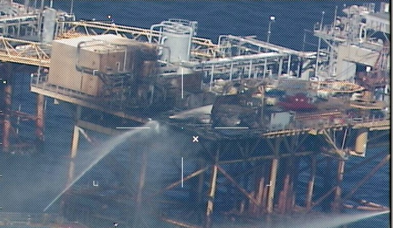 RIG FIRE. Commercial vessels spray water to extinguish a platform fire on board the West Delta 32 oil rig in the Gulf of Mexico off Grand Isle, Louisiana on November 16, 2012. AFP PHOTO / HNADOUT / US COAST GUARD
