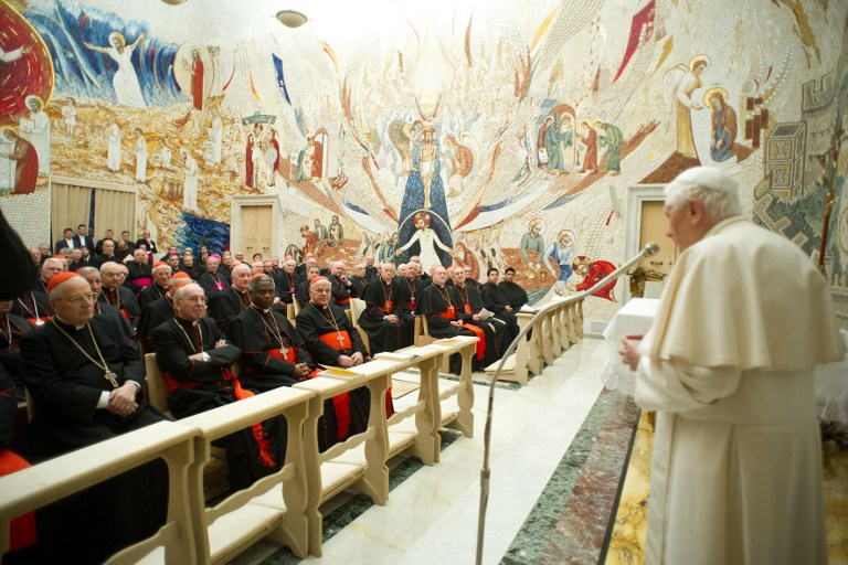 ROMAN CURIA. This handout photograph provided by Osservatore Romano shows Pope Benedict XVI addressing cardinals and prelates of Roman curia during a meeting, the day of the closing of the Spiritual Exercises at the Vatican on February 23, 2013. AFP Photo/Osservatore Romano