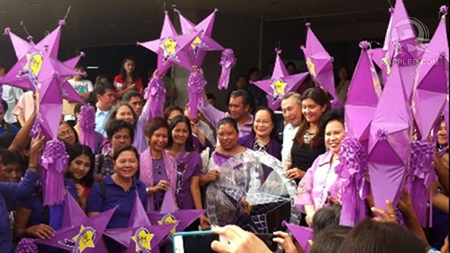"'PURPLE CHRISTMAS.' RH advocates led by the Reproductive Health Advocate Network visit the Senate to give ""RH now"" lanterns to RH sponsors Sen Pia Cayetano and Sen Miriam Defensor Santiago. Former Health Secretary Alberto Romualdez was also present. Photo by Ayee Macaraig"