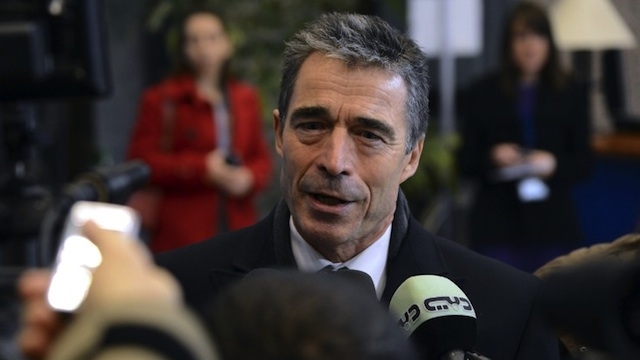 NATO chief Anders Fogh Rasmussen talks to the media upon arrival to the EU Council Building prior to the start of a meeting of European Union defense ministers, on November 19, 2012 in Brussels. AFP PHOTO/THIERRY CHARLIER