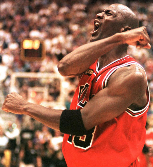 SIXTH RING. Michael Jordan of the Chicago Bulls celebrates 14 June after winning game six of the NBA Finals against the Utah Jazz at the Delta Center in Salt Lake City, UT. The Bulls won the game 87-86 to win their sixth NBA Championship. AFP PHOTO/Robert SULLIVAN