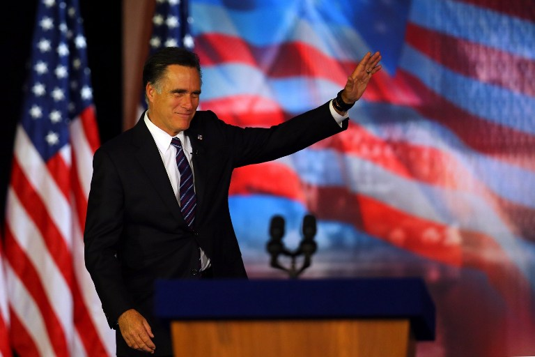 Republican presidential candidate, Mitt Romney, waves to the crowd before conceding the presidency during Mitt Romney's campaign election night event at the Boston Convention & Exhibition Center on November 7, 2012 in Boston, Massachusetts. Joe Raedle/Getty Images/AFP