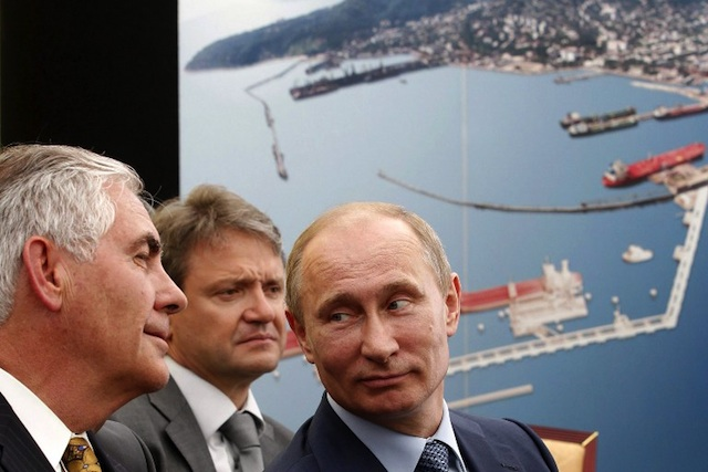 ENERGY POWER. Russia's President Vladimir Putin (R) and ExxonMobil Chairman and CEO Rex Tillerson Wayne (L) attend at the ceremony of the signing of an agreement between state-controlled Russian oil company Rosneft and ExxonMobil in the Black Sea port of Tuapse on June 15, 2012. Photo by AFP