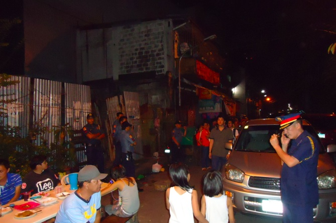 NOTHING UNUSUAL? Cops turn up at the opposition's barangay event in Binondo, Manila on February 27. Photo by Jerald Uy