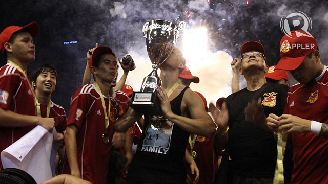 VICTORIOUS. Spanish Rufo Sanchez kisses the trophy after winning the UFL Cup. Photo by Josh Albelda.