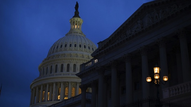 The U.S. Capitol illuminates at dusk on Capitol Hill on December 31, 2012 in Washington, DC. Drew Angerer/Getty Images/AFP