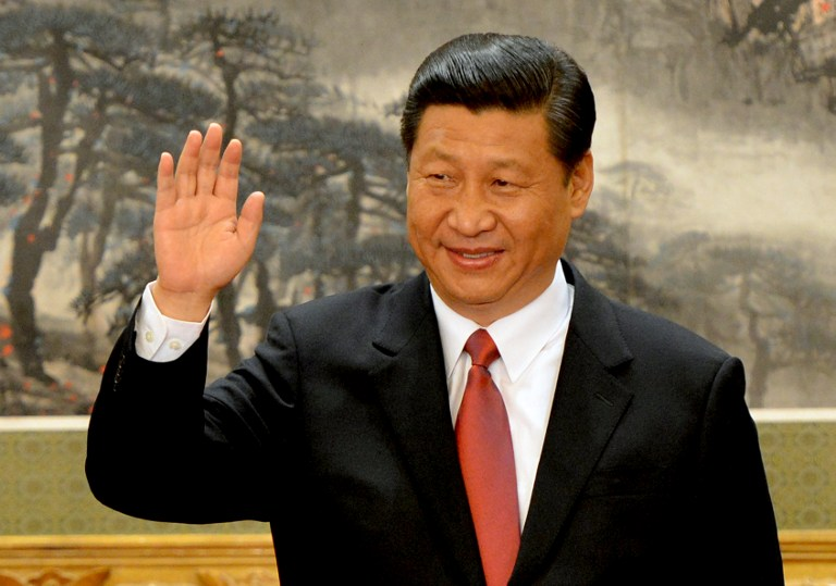 XI IS IT. Chinese Vice president Xi Jinping emerges as the head of the newly reshuffled seven member Communist Party of China Politburo Standing Committee, the nation's top decision making body at the Great Hall of the People in Beijing on November 15, 2012. AFP PHOTO/Mark RALSTON