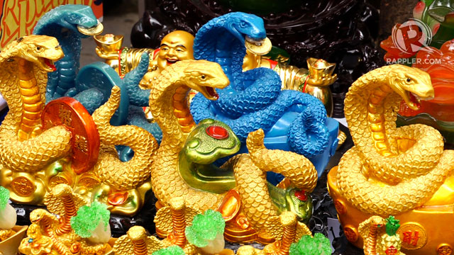 SNAKE CHARM-ERS. Water Snake figurines are the choice souvenirs this Chinese New Year
