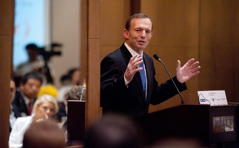 Australian opposition leader Tony Abbott in a file photo taken July 24, 2012. AFP PHOTO / GOU YIGE